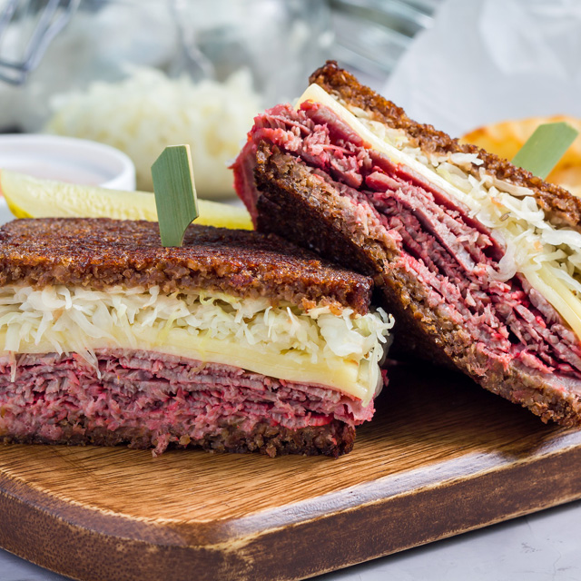 Classic reuben sandwich, served with dill pickle, potato chips, horizontal:Relish Life's Sweet and Sauer Moments with a Sandwich:haccola Japanese fermented foods and cuisine